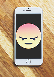 frowning emoji on cell phone